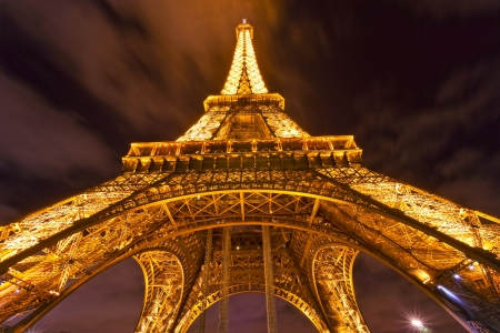 PARIS - DECEMBER 05: Lighting the Eiffel Tower on December 05, 2012 in Paris. Established in 1985, the new system allowed the tower to glow golden glow. The Eiffel tower is the most visited monument of France.