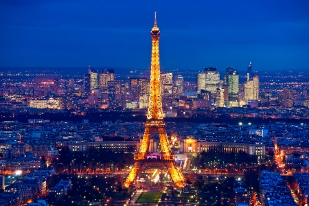 newsworthy: PARIS - DECEMBER 05: Lighting the Eiffel Tower on December 05, 2012 in Paris. Established in 1985, the new system allowed the tower to glow golden glow. The Eiffel tower is the most visited monument of France.