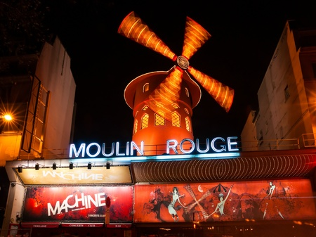locating: PARIS - DECEMBER 10  The Moulin Rouge by night, on December 10, 2012 in Paris, France  Moulin Rouge is a famous cabaret built in 1889, locating in the Paris red-light district of Pigalle