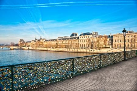 arts symbols: View of the Louvre Museum and Pont ses arts, Paris - France