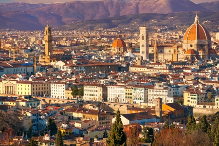 Florence, view of Duomo and Giotto's bell tower and palazzo vecchio at sunset. photo