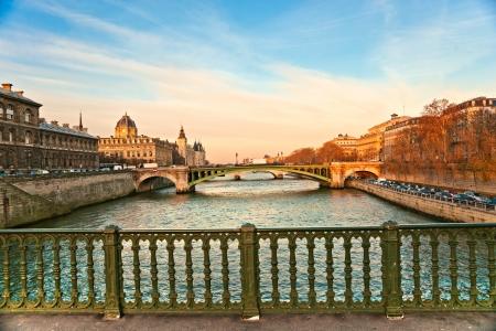 Palais de Justice standing on the banks of river Seine on the Ile de la Cite, Paris - France photo