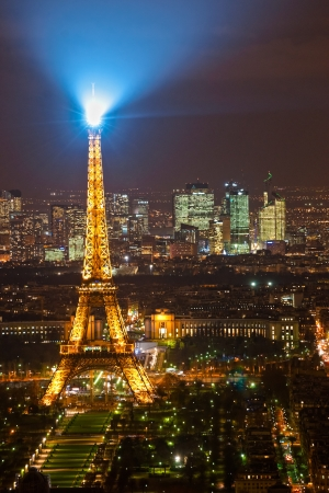 newsworthy: PARIS - DECEMBER 05  Lighting the Eiffel Tower on December 05, 2012 in Paris  Established in 1985, the new system allowed the tower to glow golden glow  The Eiffel tower is the most visited monument of France