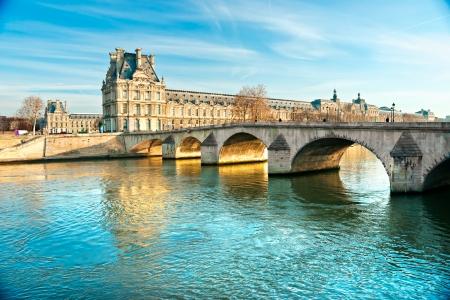 View of the Louvre Museum and Pont ses arts, Paris - France