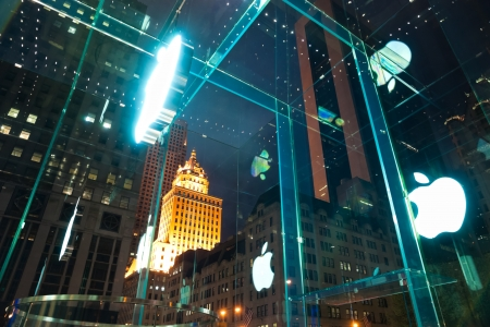 fifth: NEW YORK - AVRIL 01: Apple Store sign on Fifth Avenue. The store in itself is all underground except for the 32-foot glass cube right in front of the GM building, Avril 01, 2012 in New York.