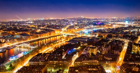 Aerial view of Paris at night, France.