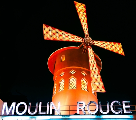 moulin: PARIS - DECEMBER 10: The Moulin Rouge by night, on December 10, 2012 in Paris, France. Moulin Rouge is a famous cabaret built in 1889, locating in the Paris red-light district of Pigalle  Editorial