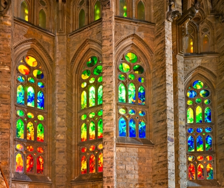 uncomplete: BARCELONA, SPAIN - DECEMBER 14: Colorful window of La Sagrada Familia - the impressive cathedral designed by Gaudi, which is being build since 19 March 1882 and is not finished yet December 14, 2011 in Barcelona, Spain.