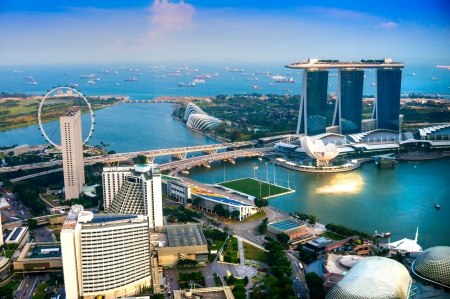singapore city: Fish-eye view of Singapore city skyline at sunset.   Stock Photo
