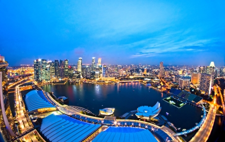 Fish-eye view of Singapore city skyline at sunset.