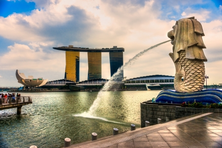 merlion: SINGAPORE-MARCH 19 : The Merlion and the Marina Bay Sands Resort Hotel, billed as the worlds most expensive standalone casino property at S$8 billion on March 19, 2013 in Singapore.