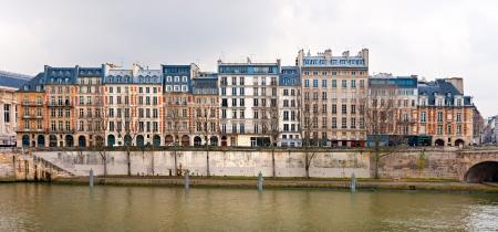 Palais de Justice standing on the banks of river Seine on the Ile de la Cite, Paris - France