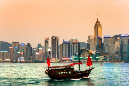 drove: HONG KONG - MARCH 15: Victoria Harbor on March 15, 2013 in Hong Kong. An old chinese junk departed from Ocean Terminal and drove across Victoria Harbor.