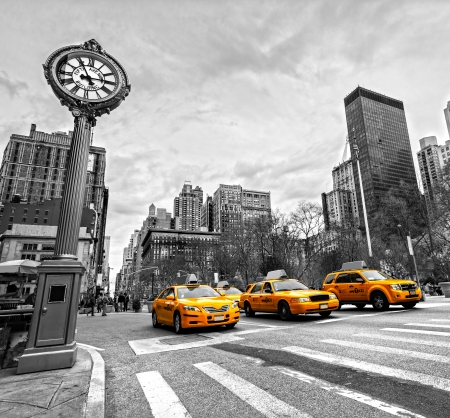 NEW YORK - JULY 21: Yellow taxis on 5th Avenue on July 21 2012 in New York, USA. 5th Avenue is a central road of Manhattan, the most expensive shops and apartmens situated here Editorial