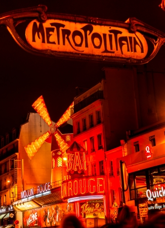 locating: PARIS - DECEMBER 10: The Moulin Rouge by night, on December 10, 2012 in Paris, France. Moulin Rouge is a famous cabaret built in 1889, locating in the Paris red-light district of Pigalle  Editorial
