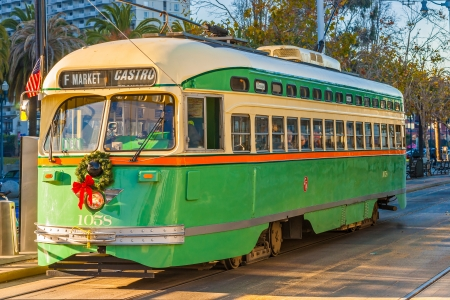 f 16: SAN FRANCISCO, USA - DECEMBER 16  F Market e Wharves rail line on Dec 16, 2013 in San Francisco  the F line is operated as a heritage streetcar service, using exclusively historic equipment both from San Francisco Editorial