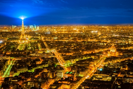 Aerial view of Paris at night, France.