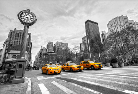 NEW YORK - JULY 21: Yellow taxis on 5th Avenue on July 21 2012 in New York, USA. 5th Avenue is a central road of Manhattan, the most expensive shops and apartmens situated here