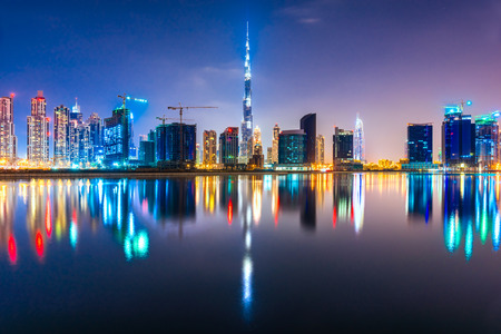 biggest: Dubai skyline at dusk, UAE. Stock Photo