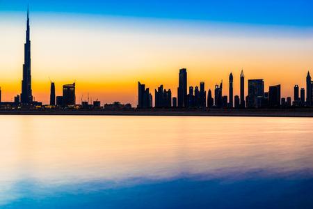 gulf: Dubai skyline at dusk, UAE. Stock Photo