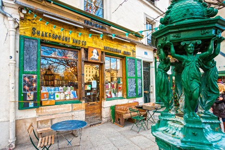 ile de la cite: PARIS-DECEMBER 11: The Shakespeare and Co. bookstore on December 11, 2012 in Paris, Opened in 1951 by George Whitman, it serves both as a regular bookstore and as a reading library, specializing in English-language literature.