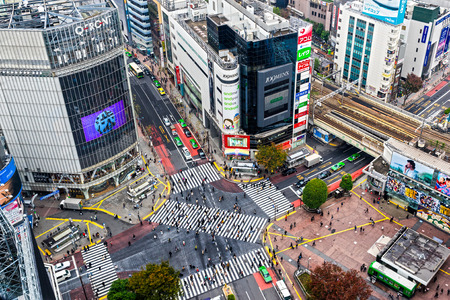 TOKYO - NOVEMBER 15: Shibuya Crossing November 12, 2014 in Tokyo, Japan. The crossing is one of the worlds most well known examples of a scramble crosswalk.