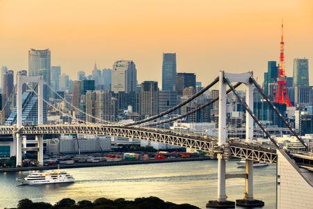 japan sunset: Tokyo skyline with Tokyo tower and rainbow bridge. Tokyo, Japan.