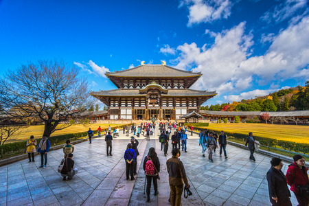 NARA ,JAPAN - NOVEMBER 27 , 2014 :Todaijis main hall, the Daibutsuden (Big Buddha Hall) is the worlds largest wooden building, It is one of Japans most famous and historically significant temples of Nara