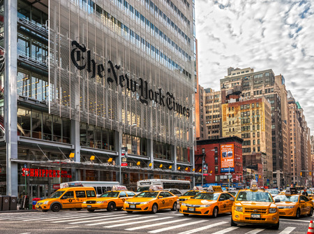 new york times: NEW YORK CITY - DEC 01 The New York Times building and characteristic Yellow Taxi Cab,on December 01th, 2013 in Manhattan, New York City. USA.