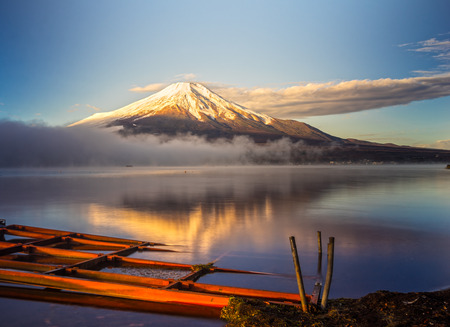 japan sky: Mount Fuji reflected in Lake Yamanaka at dawn, Japan.