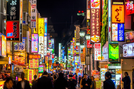 TOKYO - NOVEMBER 13: Billboards in Shinjuku's Kabuki-cho district November 13, 2014 in Tokyo, JP. The area is a nightlife district known as Sleepless Town. Stock Photo - 67237449