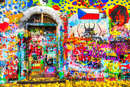 PRAGUE, CZECH REPUBLIC - NOVEMBER 06: The Lennon Wall since the 1980s filled with John Lennon-inspired graffiti and pieces of lyrics from Beatles songs on November 06, 2015 in Prague, Czech Republic