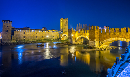 loopholes: Verona, Italy. Scenery with Adige River and Ponte Scaligero and Castelvecchio,