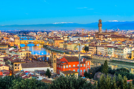 Sunset view of Ponte Vecchio and Palazzo Vecchio, Florence, Italy.