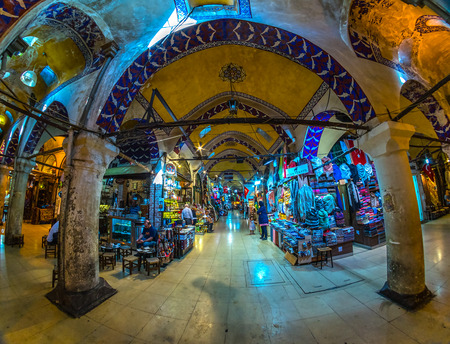 souvenir: ISTANBUL, TURKEY - OCTOBER 13, 2016: Grand Bazaar in Istanbul with unidentified people. It is one of the largest and oldest covered markets in the world, with 61 covered streets and over 3,000 shops