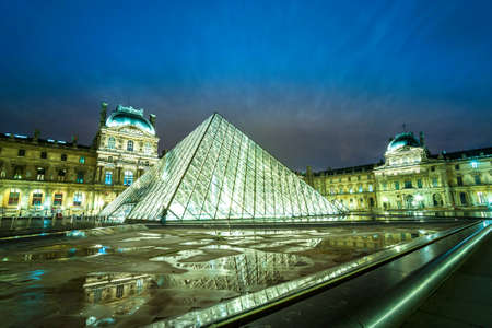 sq: PARIS-DECEMBER 06: The Louvre Museum on December 06, 2012 in Paris, France. A central landmark of Paris, over 35000 objects from prehistory to the 19th century are exhibited over area of 60600 sq m. Editorial