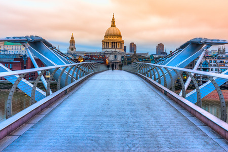 millennium bridge: St. Pauls cathedral and Millennium Bridge, London, UK Stock Photo