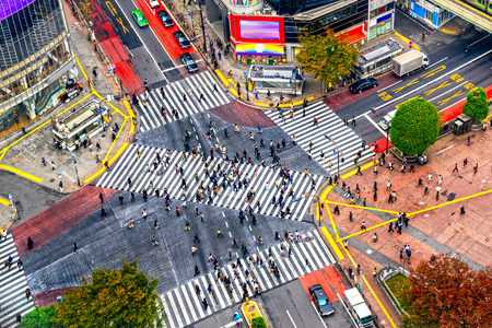 scramble: Shibuya District and Shibuya Crossing, Tokyo. The scramble crosswalk is one of the largest in the world.