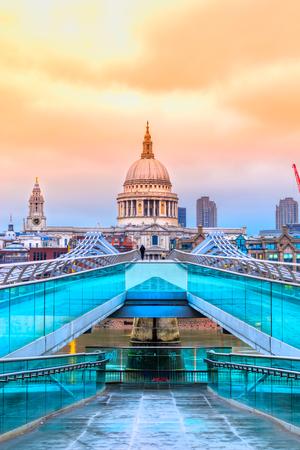 St. Pauls cathedral and Millennium Bridge, London, UK Editorial