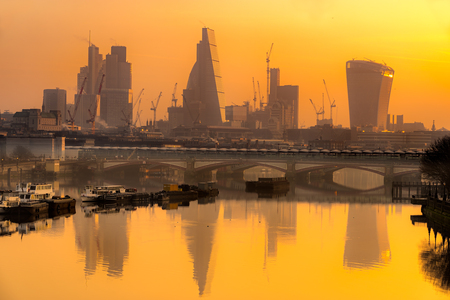 City of London skyline at sunrise with St. Paul basilica and modern skyscarpers, London, UK
