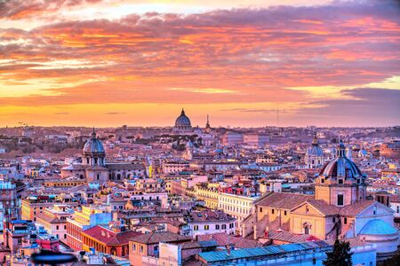 Wonderful view of Rome skyline at sunset time with St Peter Cathedral Banco de Imagens