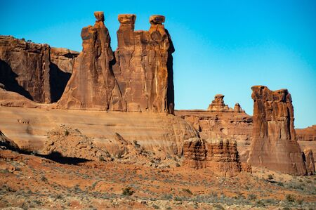 The Three Gossips, famous orange rock formation near Arches National Park, Utah, USA.