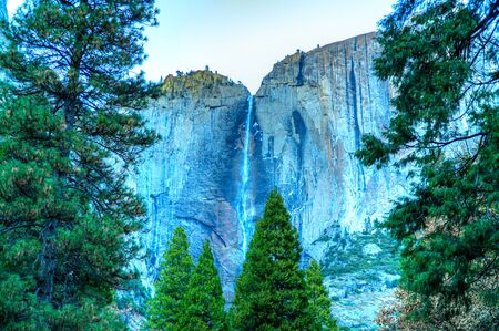 View of a waterfall fading into the forest, Yosemite National Park, Califfornia, USA. Stock Photo