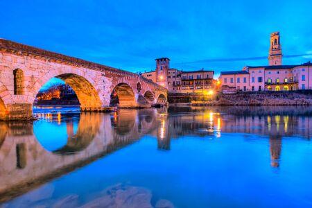 Verona, Italy. Scenery with Adige River and Ponte di Pietra, old roman bridge.tictt Veneto