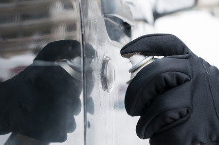 frost winter: Closeup of man hand with lock door de-icer