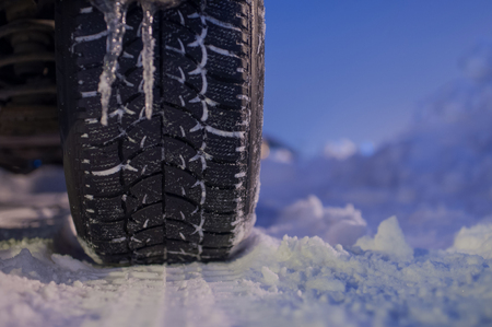 winter tyre: Winter tyre on the road with snow