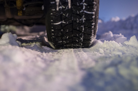 winter tyre: Winter tyre on the road, selective focus, shalow depth of field