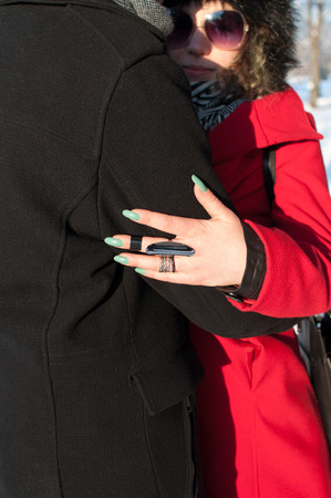 couple winter: Young couple embracing. Outdoors winter Stock Photo