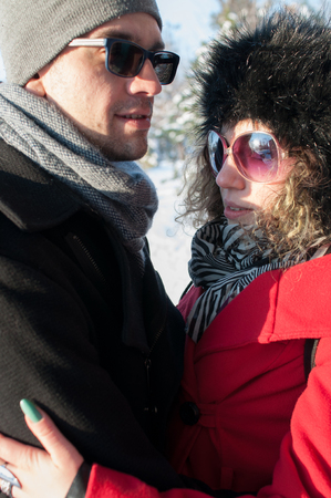 Young couple embracing. Outdoors winter 版權商用圖片
