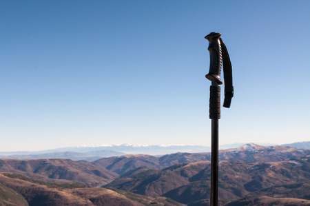 Hiking pole on the top of the mountain